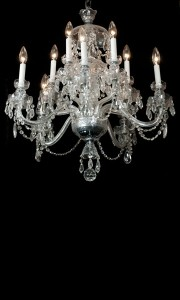 Two tier cut crystal ten light chandelier with draped crystal prisms
