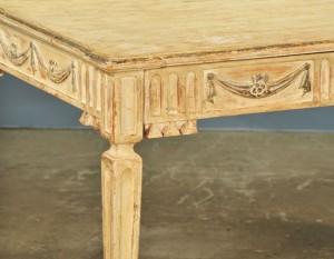 Corner of Louis XVI-style writing table, showing detail