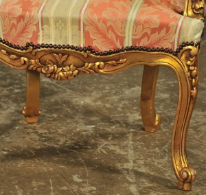 detail of carved apron, Louis XV-style gilded fauteuils, antique reproductions