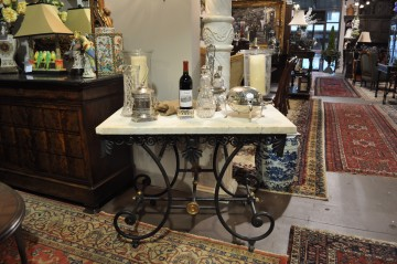 antique French marble-topped iron butcher's table on display in gallery
