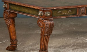 Detail, antique Regency style bureau plat, bronze lion head mounts to corners supported on acanthus carved legs on paw feet