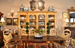 antique pine breakfront, table, and rush-seated chairs